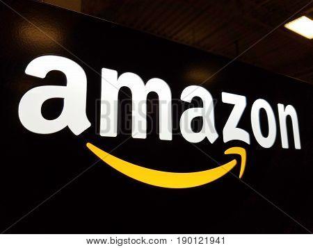 HONOLULU - JANUARY 12 2017: Amazon logo on black shiny wall in Honolulu Best Buy store on January 12 2017. Amazon is an American international electronic commerce company. It is the world's largest online retailer.