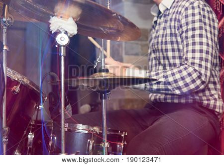 A playing the drum set . A photo