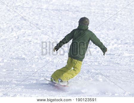people snowboarding on the snow . A photo