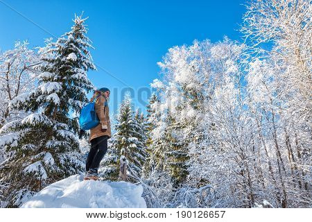 Young Woman Hiking In Winter Forest