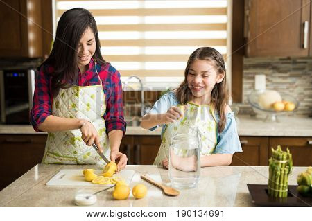 Single Mom And Daughter Working As A Team