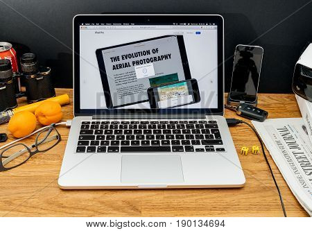 PARIS FRANCE - JUNE 6 2017: Apple Computers website on MacBook Retina in creative environment showcasing latest news from Apple at WWDC 2017 - copy/paste feature of iphone