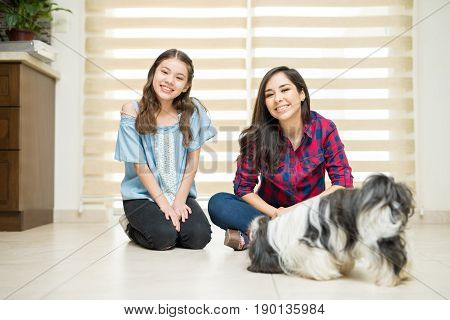 Mother, Daughter And A Dog