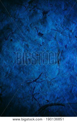 Abstract navy blue texture and background for designers. Vintage paper background. Rough blue texture of recycled paper. Closeup view of abstract dark blue texture. Vintage blue paper.