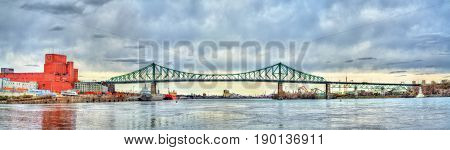 Panorama of Jacques Cartier Bridge crossing the Saint Lawrence River in Montreal - Quebec, Canada