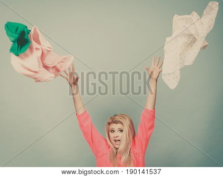 Shocked Woman Throwing Clothes Above Head