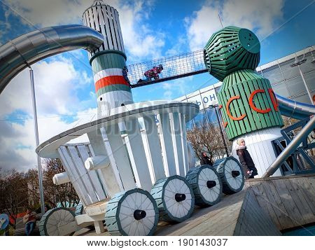 VDNKH, MOSCOW, APR,23, 2017: Incredible unusual fantastic colorful space aerospace childred playground entertainment with USSR famous rockets VOSTOK, SOUZ with metal slides, lunar rover Lunokhod.