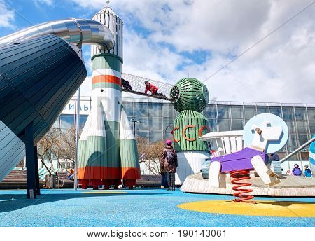 VDNKH, MOSCOW, APR,23, 2017: Incredible unusual fantastic colorful space aerospace childred playground with USSR famous rockets VOSTOK, SOUZ with slides, dog Layka, lunar rover Lunokhod entertainment