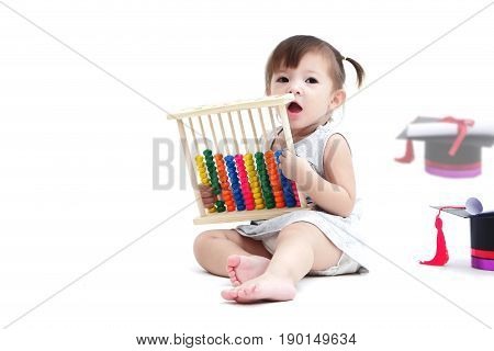 A mestizo lovely girl playing with abacus is calculator make from wooden paint full color and a graduate hat a roll of certificate with red ribbon lay isolated on white background and copy space
