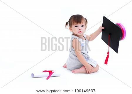 A Cute girl mestizo holding graduate hat in hand. And a roll of white certificate with red ribbon lay isolated on white background and copy space