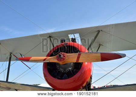 Retro biplane front closeup view of propeller and engine