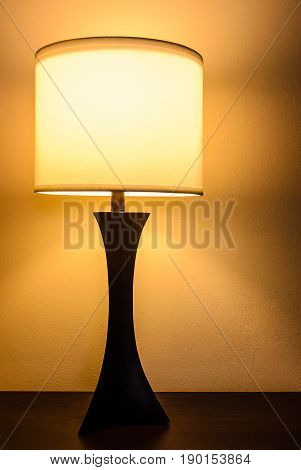 Bedroom table lamp in orange tones low light