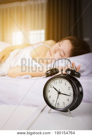 Clock Show 10 Am. And Woman Sleeping On Bed With Sunlight In Morning