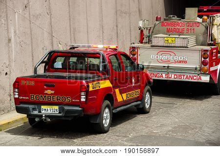 Quito, Ecuador - December 09, 2016: Fire car and fire truck parking in the streetss of Quito.