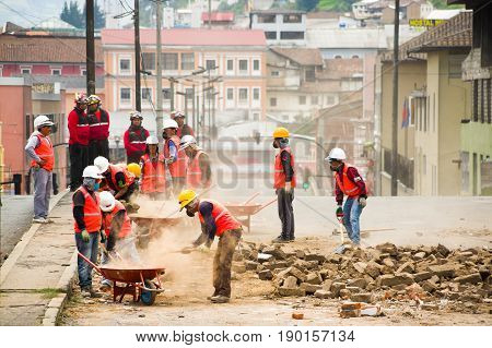 Quito, Ecuador - December 09, 2016: An unidentified group of firemans, with a construction stuffs cleaning the damage area and destruction after fire Inferno in buildings.