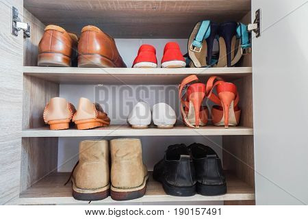 men and women fashionable shoes in wardrobe for work