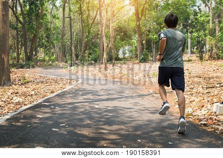 Running Man. Male Runner At Sprinting Speed Training For Marathon Outdoors