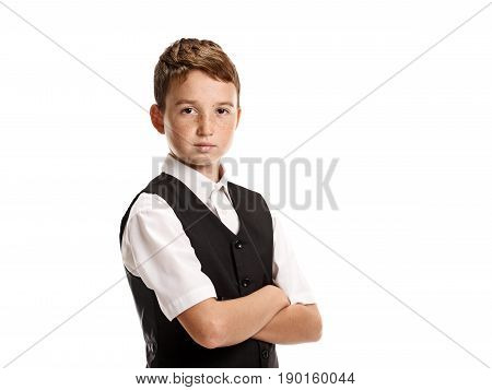 Portrait of serious smart young schoolboy with crossed hands