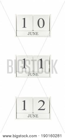 Closeup group of white wooden calendar with black 10 june 11 june 12 june word three date calendar isolated on white background