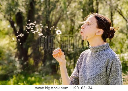 Woman And Blowball (dandelion)
