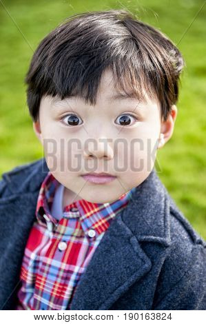 Surprised Chinese boy