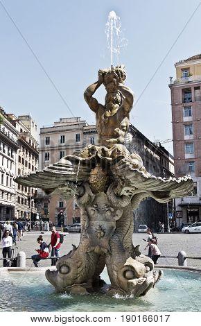Rome, Italy - April  13, 2017:Triton Fountain in Piazza Barberini in the historic center of Rome, Italy