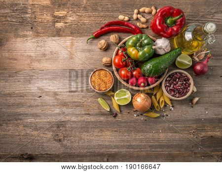 Variety of fresh farm vegetables on dark table, additional space for text left, topview