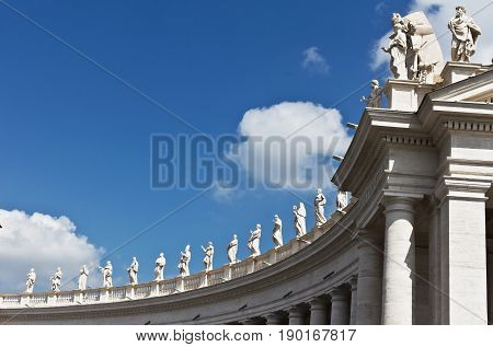 Rome, Italy - April 14, 2017: Statues on the colonnade. St. Peter's Square. Vatican City, Rome, Italy