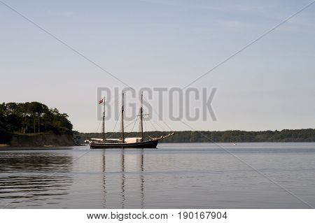 Old three-master merchant ship on the way to Little Belt in Denmark.