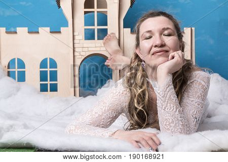 Ugly Woman In White Dress Posing Near Children House