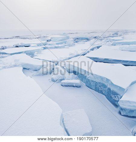Turquoise Ice Floe. Ice-drift Of Baikal Lake. Winter Landscape.