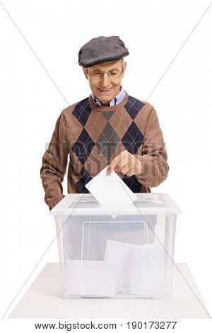 Mature voter putting a ballot into a voting box isolated on white background