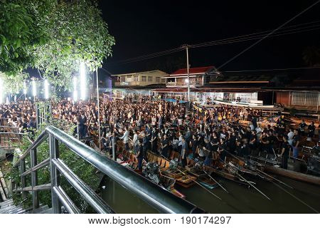 RatchaburiThailand - October 292016 : Blurred focus of Thai people waiting sing the anthem and hold the candles on the boat pray for his Majesty King Bhumibol Adulyadej's at Damnoen Saduak canal