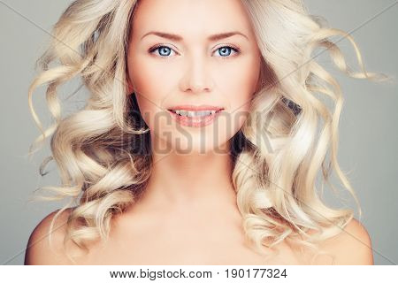 Nice Blonde Smiling Woman Fashion Model with Blowing Hair. Blonde Beauty