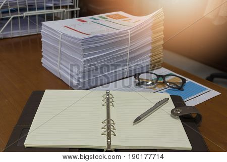 Pile of unfinished documents on office desk Stack of business paper