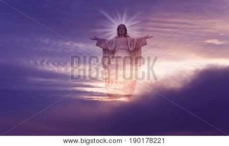 Jesus Christ statue against beautiful sky background