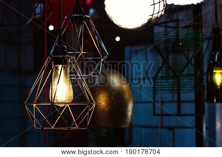 Edison's light bulb and lamp in modern style. Warm tone light bulb lamp, loft lamps, vintage, retro style. Lamps in coffee shop. Edison's lightbulb in interior.