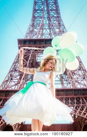 copy Eiffel Tower. Beautifu girl with Eiffel tower on background.