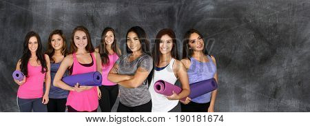 Group of young women doing a yoga class together
