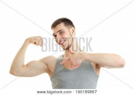 hilarious Sports Guy shows his muscle on hand close-up isolated on white background