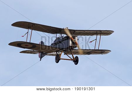 NORTHILL, UK - OCTOBER 5: A vintage SE5a fighter aircraft from the WW1 era prepares to land at the Old Warden aerodrome having given a display to the public on October 5, 2014 in Northill.