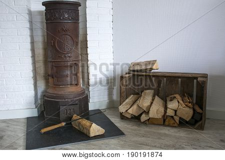 Very old furnace with some firewoods around it