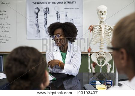 Biology teacher teaching biology to diverse group of high school students