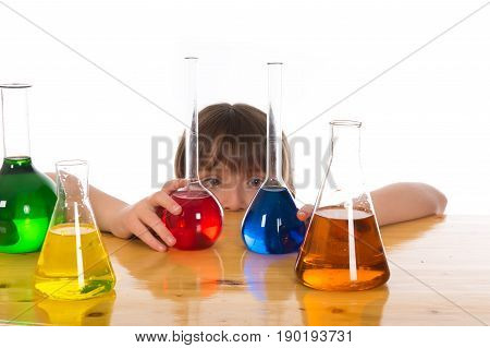 girl doing chemistry science experiment with colorful reagents in school isolated on white