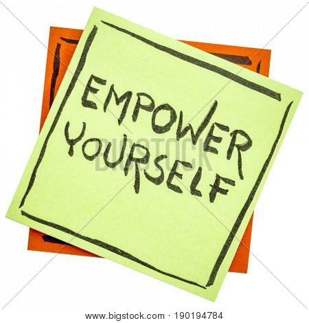 empower yourself reminder - motivational text on an isolated sticky note