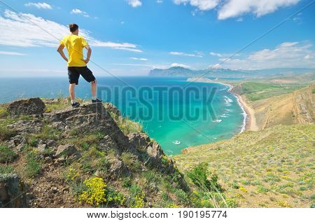 Man enjoy the nature landscape. Sea and mountain.