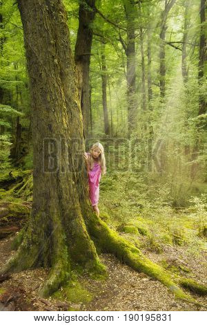 Caucasian woman playing in forest
