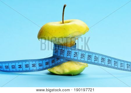 Apple Bitten And Tied With Blue Measuring Tape