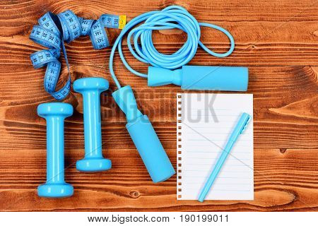 Sport Program Concept With Notebook, Skipping Rope And Dumbbells, Centimeter