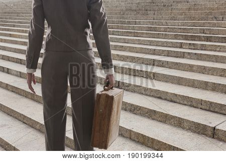 Mixed race businesswoman carrying briefcase